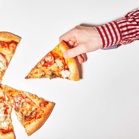 Top view. Flat lay photograph of tasty italian pizza on white background