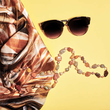Flat lay fashion set: two sunglasses on pastel backgrounds