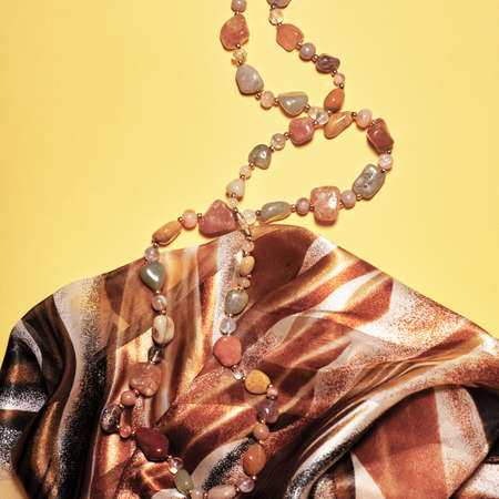 Flat lay fashion set: necklace on pastel backgrounds