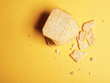 Minimalism. Flat lay. Top view. Unhealthy food. Salty crackers