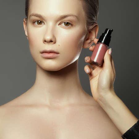 Makeup artist applies cosmetics. Beautiful woman face. Perfect makeup. Makeup detail. Beauty girl with perfect skin. Nails and manicure