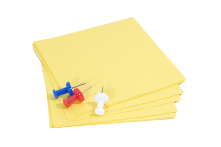 paper pin: Colorful pin with paper note on white background. Stock Photo