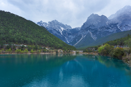 Beautiful view of Blue Moon Valley in Jade Dragon Snow Mountain reflected in clear water. Its in Lijiang, Yunnan, China