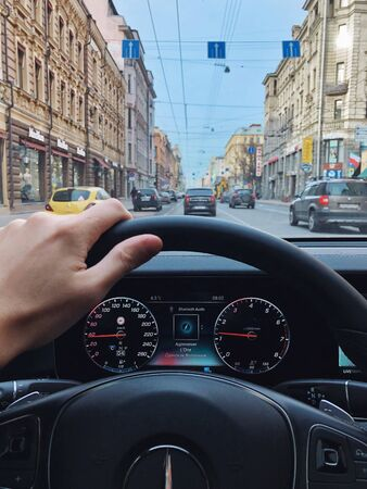 SAINT-PETERSBURG, RUSSIA - APRIL 30, 2018: Man driving Mercedes E-class w213 car pov