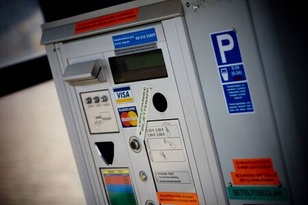 HELSINKI, FINLAND - OCTOBER 29, 2008: Ship in a sea: Payment machine in parking area in a city Editöryel