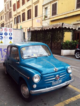 ROME, ITALY - SEPTEMBER 15 2015 Street in Rome. Blue car parking Editöryel