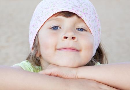 closeup of small girl on beach