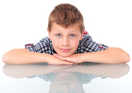 schoolboy leaning on school desk