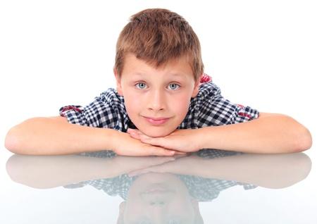 schoolboy leaning on school desk