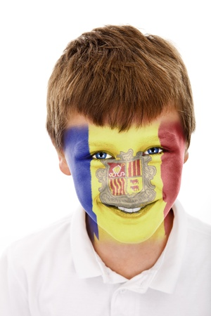 Young boy with andorra flag painted on his face photo