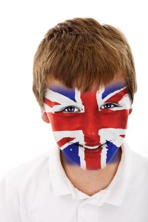 Jonge jongen met het Verenigd Koninkrijk vlag geschilderd op zijn gezicht