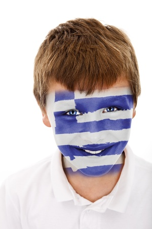 Jonge jongen met griekenland vlag geschilderd op zijn gezicht Stockfoto