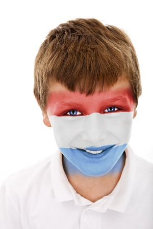 Young boy with luxembourg flag painted on his face