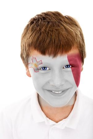 Jonge jongen met malta vlag geschilderd op zijn gezicht Stockfoto