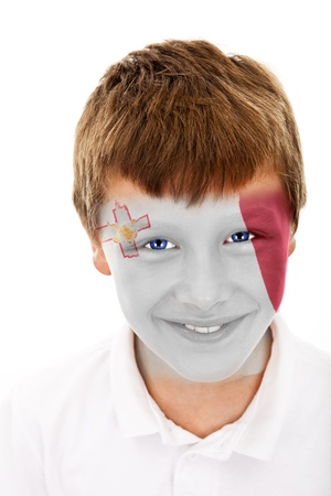 Young boy with malta flag painted on his face
