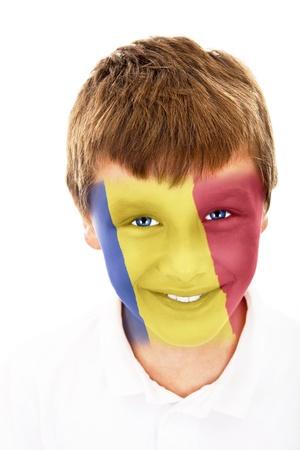 Jonge jongen met Roemenië vlag geschilderd op zijn gezicht Stockfoto