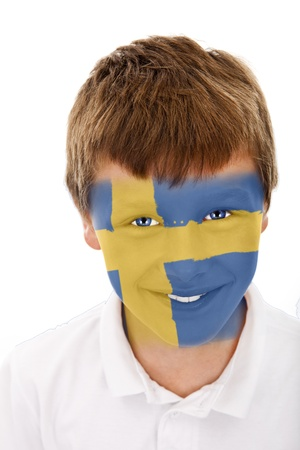 Young boy with sweden flag painted on his face Stock Photo