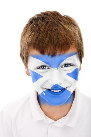 Jonge jongen met Schotland vlag geschilderd op zijn gezicht Stockfoto