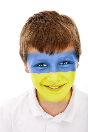Young boy with ukraine flag painted on his face