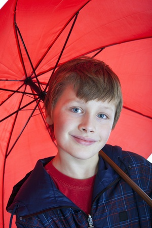 boy holding red umbrella