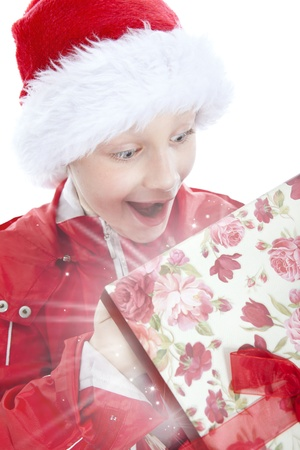 surprised boy opening present over white background