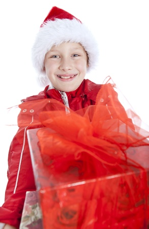 smiling boy holding present over white background