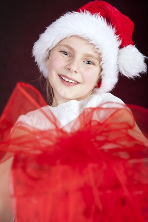 smiling young girl holding christmas present