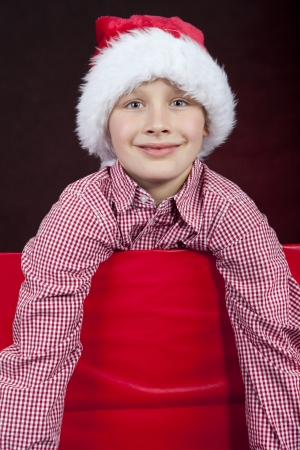 smiling christmas boy in present box Stock Photo