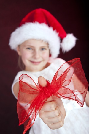 bow on christmas girl Stock Photo