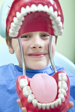 Young boy with jaw of dentist Stock Photo
