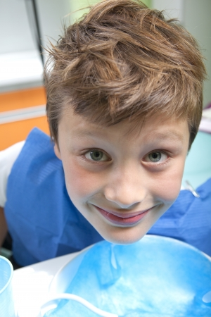 Young boy drinking water after dental operation Stock Photo - 11171075