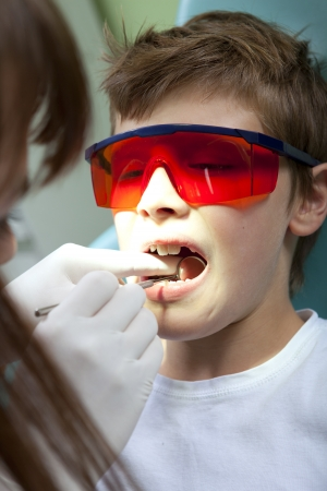 Teeth checkup at dentist photo