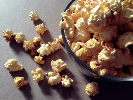 buttered: Bowl with popcorn texture background Stock Photo