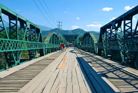 Memorial Bridge in Pai. It was built in World War II by the Japanese Army. To serve as a route to transport supplies and weapons across the Pai river to Myanmar. Stock Photo