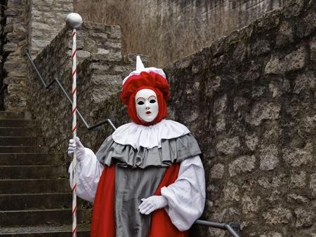 People Wearing Venetian Clown Masks photo