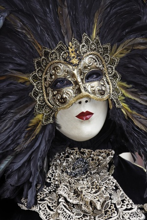 Portrait of Girl wearing feathered Venetian Mask