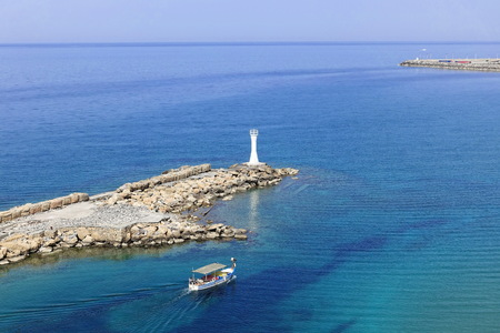 Lighthouse with boat in Girne in Northern Cyprus