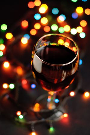 Glass of wine in new year eve with garlands photo