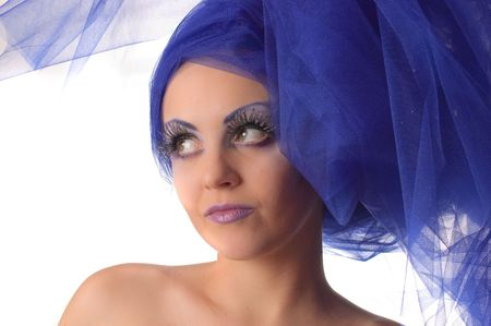 Portrait of a model with an unusual theatrical makeup photo