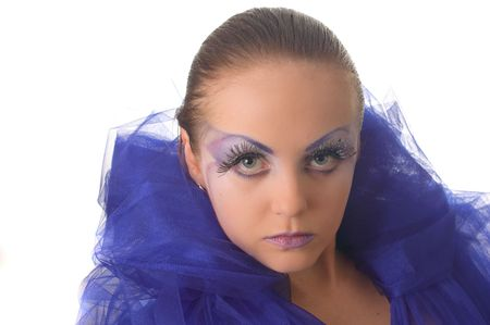 Portrait of a model with an unusual make-up in a blue cape photo
