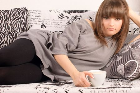 girl with a cup of cappuccino at home photo