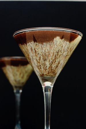 Two servings of chocolate cream dessert