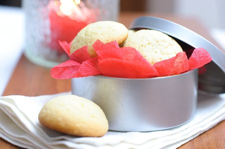 Cookies in a round box with a red paper napkin photo