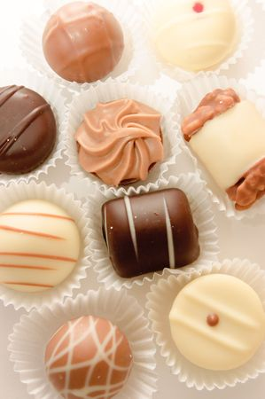 differences: different chocolates on white background Stock Photo