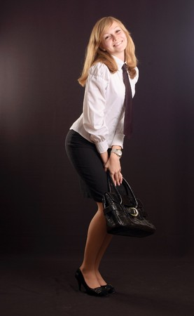 Young girl dressed as a business lady with a briefcase Stock Photo - 7146630