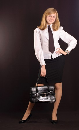 Young girl dressed as a business lady with a briefcase Stock Photo - 7146634