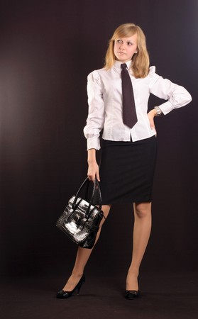 Young girl dressed as a business lady with a briefcase Stock Photo - 7146636