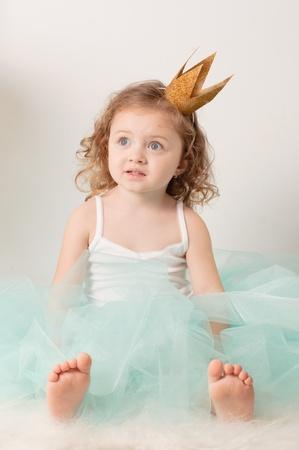 A little girl dressed elegantly played princess photo