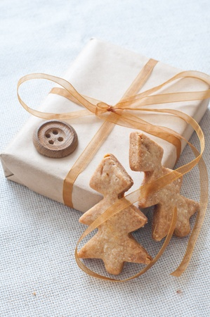Christmas gift tied with ribbon and cookies in the shape of Christmas trees photo
