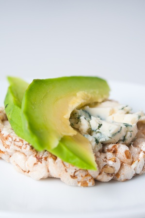 sliced cheese: Dietary appetizer with blue cheese and avocado